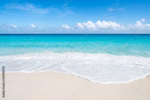 Tropical beach with white sand and turquoise water