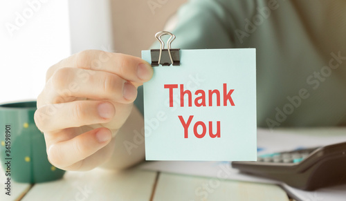 Business woman showing a post-it to thank you Canvas Print