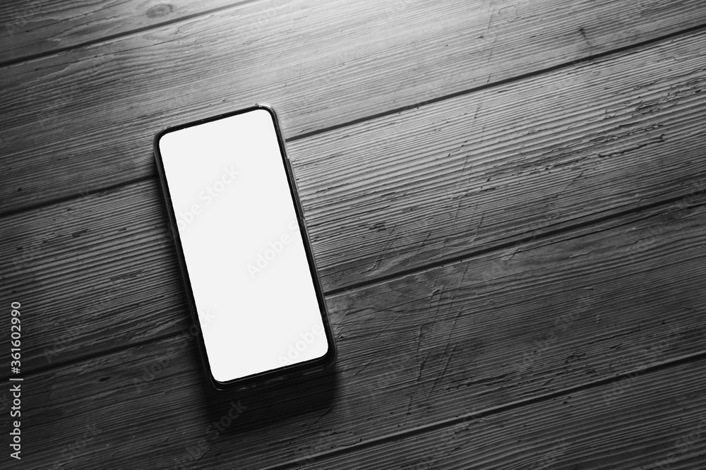 Fototapeta Black and white pictures, old phones Placed on an old wooden table for copy space