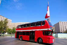 Red Double-decker Bus. Chile Flag In The Background