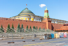 The Metal Frame Of The Spectator Tribune Stands On Red Square Near The Mausoleum And The Senate Tower Of Moscow Kremlin With Roof Of Residence Of The President Of Russia.