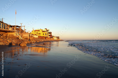 High tide sunset view of wet sand and beach homes near Los Angeles in Malibu California. #361634938