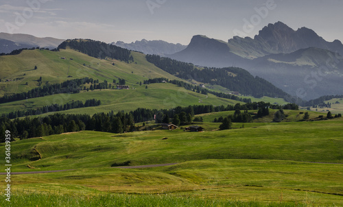 Fototapeta Alpe di Siusi/Seiser Alm, largest high altitude alpine meadow plateau in Europe and the Dolomites mountain ranges around, major tourist attraction, known for hiking & skiing, South Tirol, Italy. obraz na płótnie