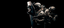 Portrait Of A Group Of Fighters Of A Special Unit. They Hide Behind A Bulletproof Shield. Black Background. Three Soldiers. The Concept Of The Fight Against Terrorism.