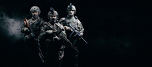 Image Of Three Soldiers In A S...