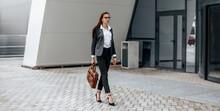 A Business Woman Checks The Ti...