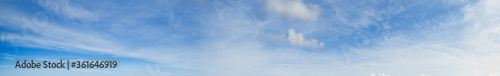 Fotografie, Tablou White fluffy cirrus and cirrocumulus clouds  in blue azure sky
