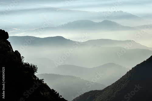 Misty canyon ridges in the hills north of Chatsworth in Los Angeles, California.   #361654325