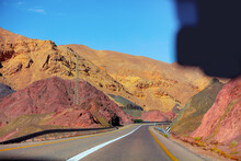 Highway In The Mountain Desert. Sandstone Mountains Along The Road. View From Car