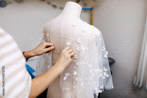 Murais de parede Work process of a tailor in her studio