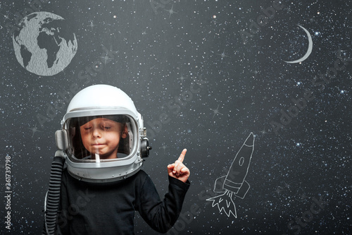 child wants to fly an airplane wearing an airplane helmet #361739798