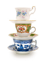 Stack Of A Variety Of Teacups On A Completely White Background. Contains Clipping Path.
