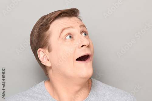 Fototapeta Portrait of funny happy impressed man with widened eyes and open mouth