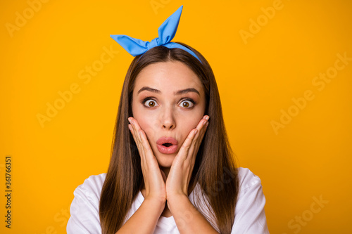 Close up photo of astonished girl look good incredible novelties scream touch hands palms cheeks wear modern clothes isolated over vivid color background