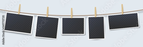 Photo Photos hanging on rope attached with clothes pins