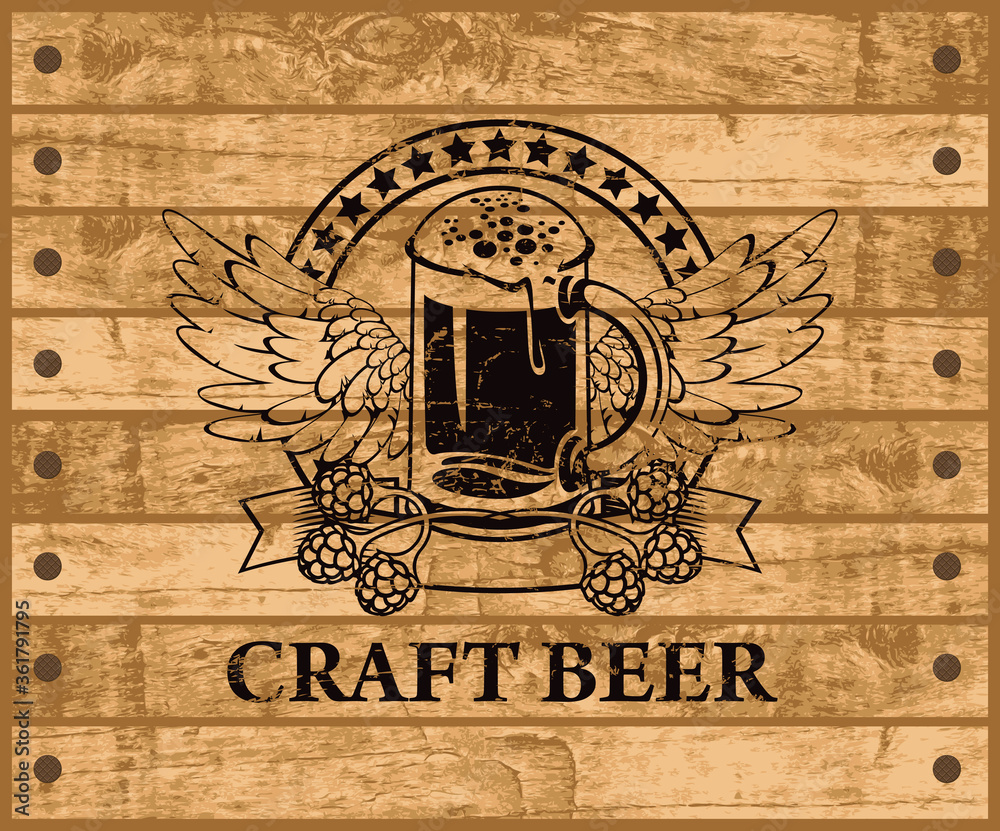 Fototapeta Label or banner for craft beer with a glass of beer, hops and wings on the background of the wooden planks. Decorative vector emblem or illustration, suitable for pub, bar and brewery graphic design