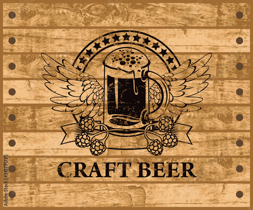 Fototapeta Label or banner for craft beer with a glass of beer, hops and wings on the background of the wooden planks. Decorative vector emblem or illustration, suitable for pub, bar and brewery graphic design obraz
