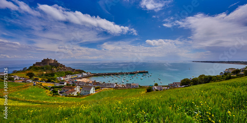Fotografija Image of Gorey Castle with Harbour, Grouville Bay calm sea and blue sky and clouds