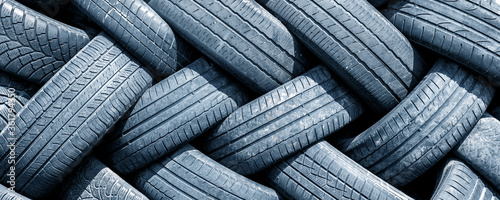 Fotomural Old used weared car and truck wheels tyres pile stacked in rows stored for recycling