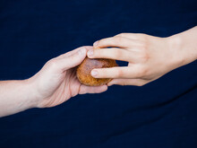 Two Hands Holding Bread