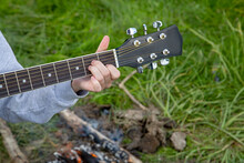 Girl's Hand Puts A Chord On A ...