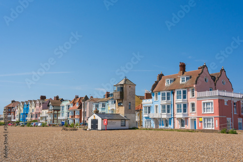 Carta da parati View of pastel coloured buildings on Crag Path facing Aldeburgh Beach on a sunny day with blue sky