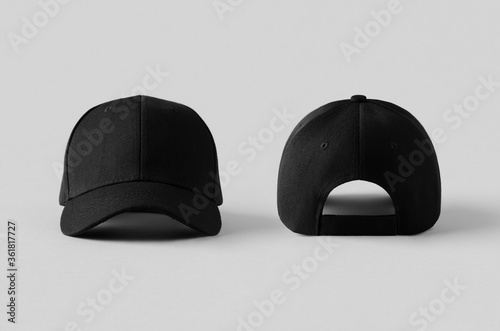 Foto Black baseball caps mockup on a grey background, front and back side