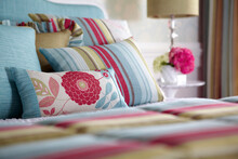 Multi-colored Pillows On Bed