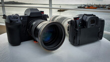 Two Black Cameras On A Boat Wi...