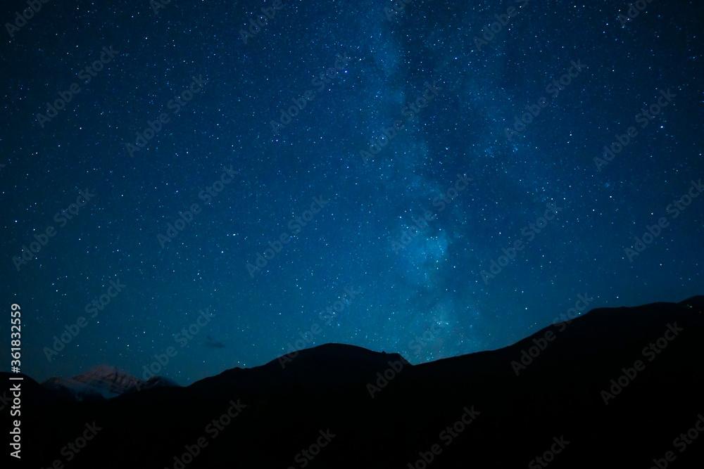 Fototapeta Mountain Silhouette Under Summer Stars Night Sky