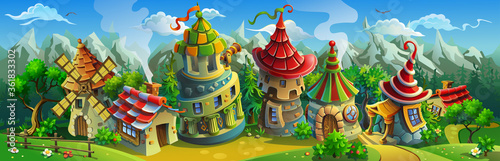 Foto A big panorama of  fairytale village with colorful houses and a mill