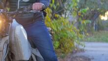 Man Kickstarting His Dirtbike At Dusk