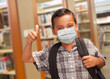 Leinwanddruck Bild - Hispanic Student Boy Wearing Face Mask with Thumbs Up and Backpack in the Library