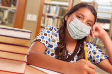 Hispanic Girl Student Wearing Face Mask Studying In Library