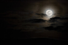 The Full Moon Among The Clouds