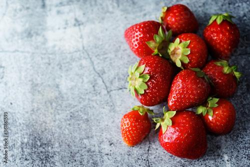 Fototapeta Raw fresh strawberries on a light background