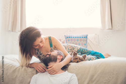 Obraz Couple in love laughing in their room - fototapety do salonu