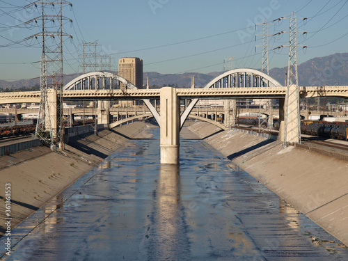 View of the Los Angeles river and old 6th street bridge in Southern California.  Bridge was torn down and replaced in 2019. #361868553