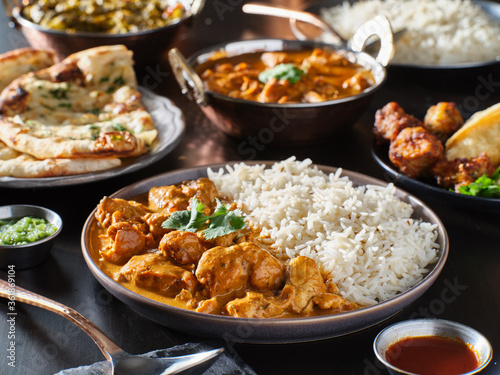 indian chicken tikka masala on plate with basmati rice Canvas Print