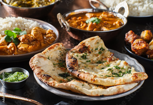 Fototapeta indian naan bread with herbs and garlic seasoning on plate obraz