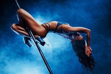 Young woman pole dancing