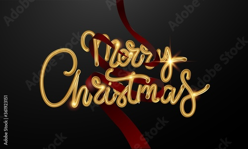 Photo The elegant calligraphic gold inscription Merry Christmas is decorated with red ribbons