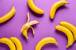canvas print picture - Ripe bananas on color background