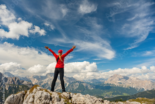 Sporty Young woman on mountain trail Dolomites Mountains, Italy Canvas Print