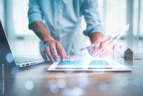 Fototapeta business finance technology and investment concept. Stock Market Investments Funds and Digital Assets. businessman analysing forex trading graph financial data. Business finance background. obraz