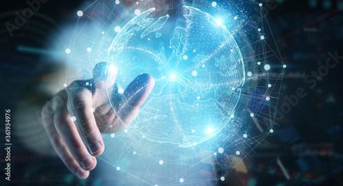 Fototapeta Businessman hand using Europe map globe network hologram 3D rendering obraz