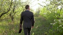 A Businessman Walks Through Th...