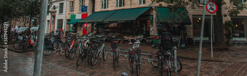 Fototapety, obrazy: Panoramic crop of row of bicycles on urban street in Copenhagen, Denmark