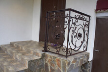 Installation Of Railings On Stairs,part Of The Metal Railing Was Fixed On The Stairs In Front Of The Door To The Lodge