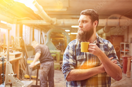 Self-employed hipster carpenter drinking coffee Canvas